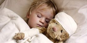 boy and teddybear in bed
